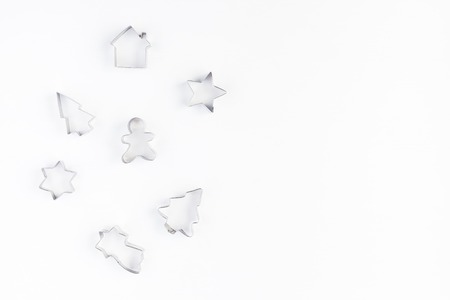 Cookie cutters on white background. Christmas, winter, new year concept. Flat lay, top view, copy space