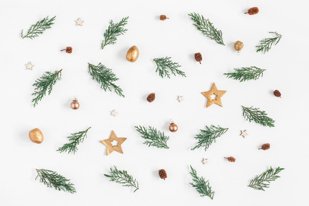 Christmas composition. Pattern made of pine branches and christmas decorations on white background. Flat lay, top view