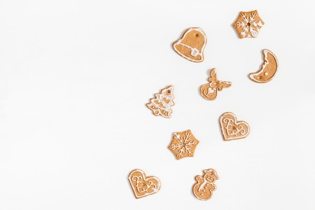 Christmas composition. Christmas gingerbread cookies on white background. Flat lay, top view, copy space