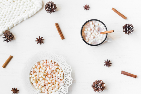 Christmas. Winter. Hot chocolate, cinnamon sticks, anise star, marshmallow, knitted blanket and cones. Christmas composition. Flat lay, top view