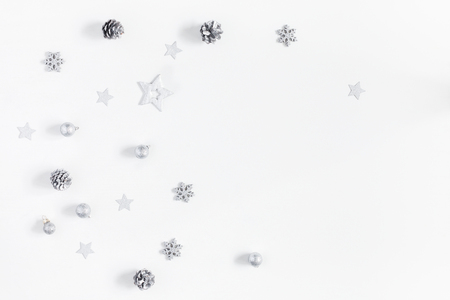 Christmas composition. Christmas silver decorations on white background. Flat lay, top view, copy space