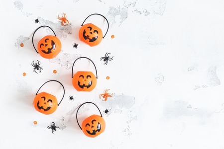 Halloween decorations. Decorative orange pumpkins on white background. Halloween concept. Flat lay, top view, copy space Stock Photo
