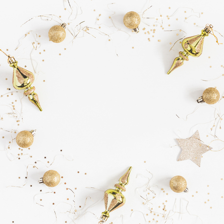 Christmas composition. Frame made of christmas golden decorations on white background. Top view, flat lay, copy space, square