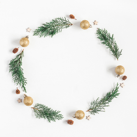 Christmas composition. Christmas wreath made of pine branches, balls, pine conces on white background. Flat lay, top view, copy space, square Stock Photo