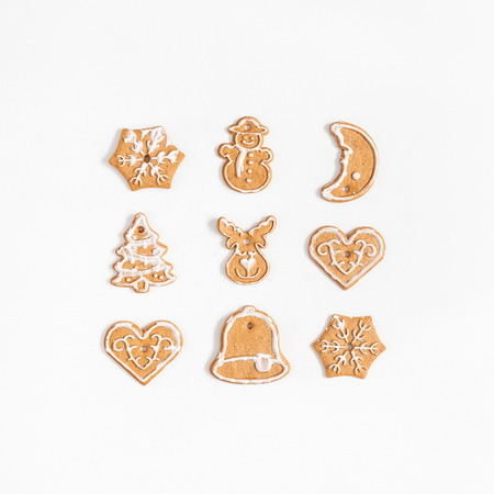 Christmas composition. Christmas gingerbread cookies on white background. Flat lay, top view, square