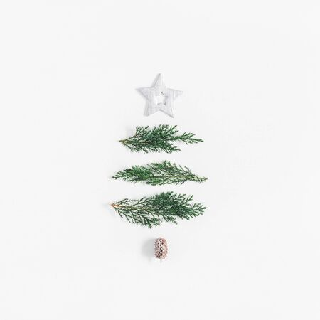 Christmas tree made of cypress branches and silver decorations. Christmas, winter, new year concept. Flat lay, top view, square