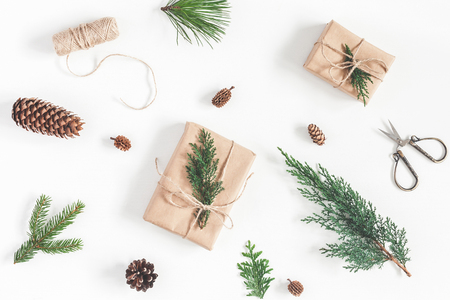 Christmas workspace. Gifts, different winter plants on white background. Christmas, winter, new year concept. Flat lay, top view