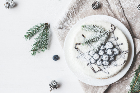 Christmas composition. Blueberry cake with fir branches, Christmas dessert. Flat lay, top view Stock Photo