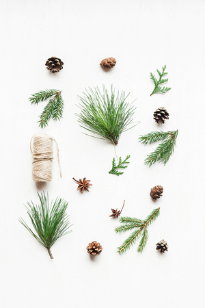 Christmas composition with pine cones, fir branches. Christmas pattern. Top view, flat lay Zdjęcie Seryjne