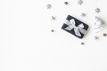 Christmas composition. Christmas gift, snowflakes, pine cones. Top view, flat lay