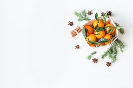 Christmas composition with tangerines, fir branches, cinnamon sticks, anise star. Christmas background. Flat lay, top view