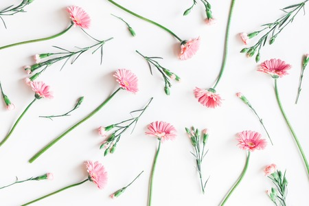 Flowers composition. Pattern made of pink flowers on white background. Flat lay, top view, copy space