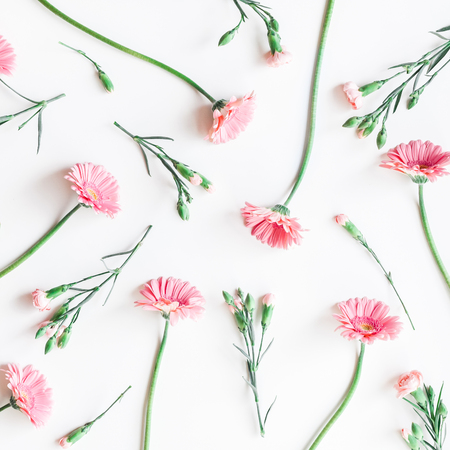 Flowers composition. Pattern made of pink flowers on white background. Flat lay, top view, square