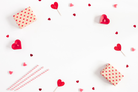 Valentines Day. Frame made of gifts, candles, confetti on white background. Valentines day background. Flat lay, top view, copy space