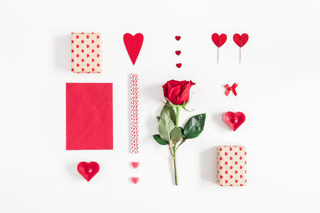 Valentines Day. Rose flower, gifts, candles, confetti on white background. Valentines day background. Flat lay, top view