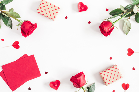 Valentines Day. Frame made of rose flowers, gifts, candles, confetti on white background. Valentines day background. Flat lay, top view, copy space