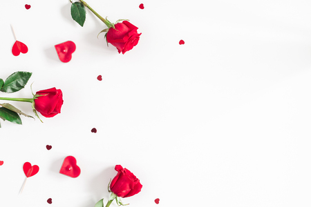 Flowers composition. Frame made of rose flowers, confetti on white background. Valentines Day background. Flat lay, top view, copy space