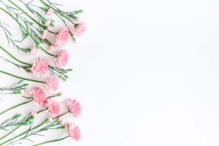 Flowers composition. Frame made of pink flowers on white background. Flat lay, top view, copy space 写真素材