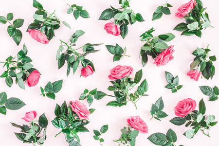 Flowers composition. Pattern made of pink rose flowers on pink background. Flat lay, top view