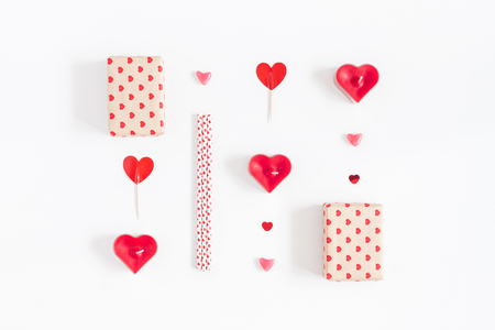 Valentines Day. Gifts, candles, confetti on white background. Valentines day background. Flat lay, top view