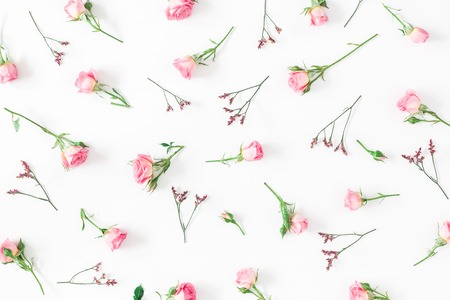 Flowers composition. Pattern made of pink rose flowers on white background. Flat lay, top view