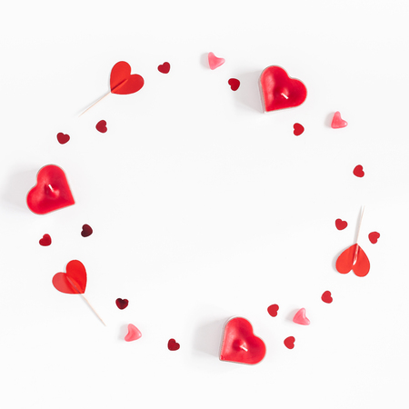 Valentines Day. Frame made of candles, confetti on white background. Valentines day background. Flat lay, top view, copy space, square