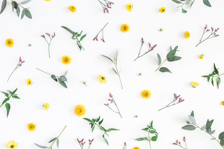 Flowers composition. Pattern made of yellow and pink flowers on white background. Flat lay, top view