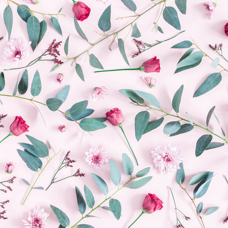 Flowers composition. Pattern made of pink flowers and eucalyptus branches on pink background. Flat lay, top view, square