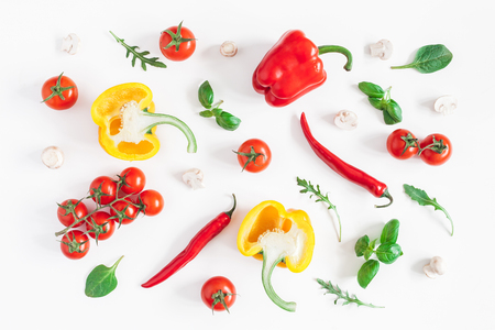 Healthy food on white background. Vegetables, tomatoes, peppers, green leaves, mushrooms. Flat lay, top view Фото со стока