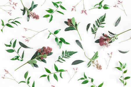 Flowers composition. Pattern made of tropical flowers and leaves on white background. Flat lay, top view