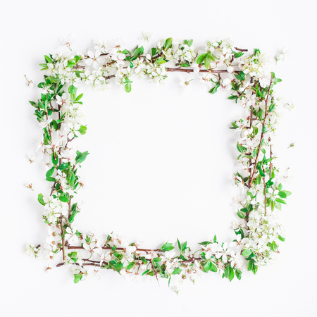 Flowers composition. Frame made of apple tree flowers on white background. Flat lay, top view, copy space, square