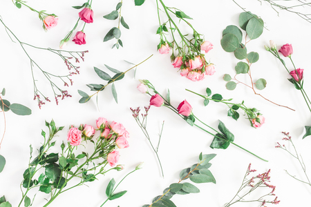 Flowers composition. Pattern made of various pink flowers and eucalyptus branches on white background. Flat lay, top view Фото со стока