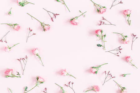 Flowers composition. Frame made of pink rose flowers on pink background. Flat lay, top view, copy space, square