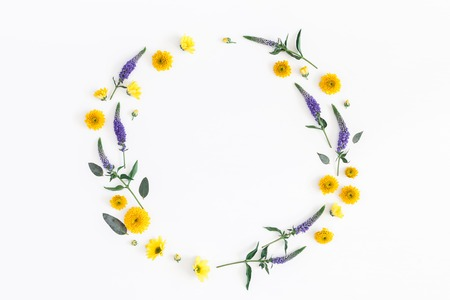 Flowers composition. Wreath made of yellow, purple flowers and eucalyptus branches on white background. Flat lay, top view, copy space