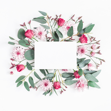 Flowers composition. Paper blank, various pink flowers and eucalyptus branches on white background. Flat lay, top view, square, copy space Stockfoto