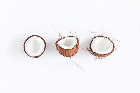 Coconut background. Fresh coconuts on white background. Flat lay, top view