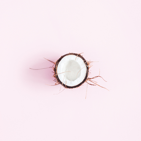 Coconut background. Fresh coconuts on pink background. Flat lay, top view, square