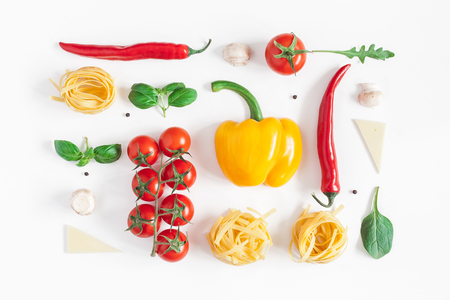 Ingredients for cooking pasta on white background. Fettuccine, fresh vegetables, cheese, mushrooms, spice. Italian food concept. Flat lay, top view