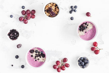 Breakfast with muesli, acai blueberry smoothie, fruits on white background. Healthy food concept. Flat lay, top view, copy space Zdjęcie Seryjne - 97103394