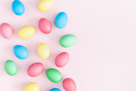 Easter eggs on pink background. Easter concept. Flat lay, top view, copy space