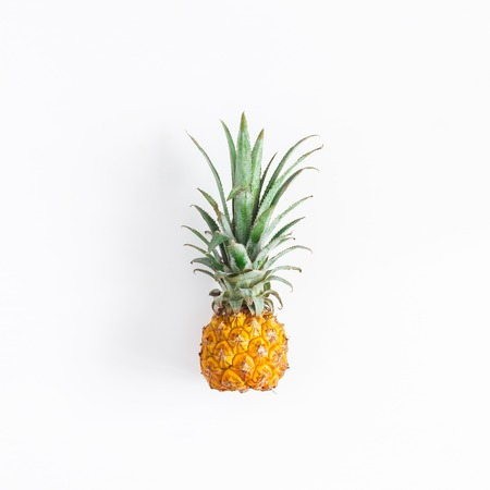 Pineapple on white background. Flat lay, top view, square