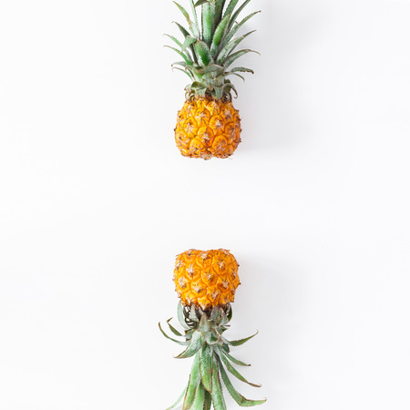 Pineapples on white background. Summer concept. Flat lay, top view, copy space Stock Photo