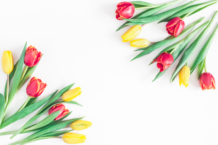 Flowers composition. Frame made of tulip flowers on white background. Flat lay, top view, copy space
