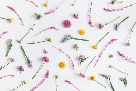 Flowers composition. Pattern made of colorful flowers on pastel blue background. Flat lay, top view Stock Photo