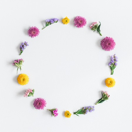 Flowers composition. Wreath made of colorful flowers on gray background. Flat lay, top view, square, copy space