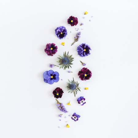 Flowers composition. Pattern made of colorful flowers on gray background. Flat lay, top view, square