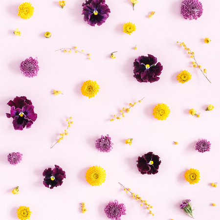 Flowers composition. Pattern made of colorful flowers on pink background. Flat lay, top view, square Stock Photo