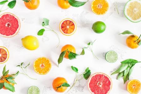 Fruit pattern. Colorful fresh fruits on white table. Orange, tangerine, lime, lemon, grapefruit. Flat lay, top view Stock Photo
