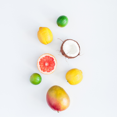 Summer tropical composition. Tropical fruits on gray background. Summer concept. Flat lay, top view, square