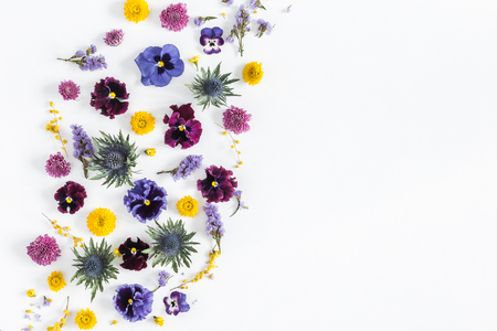 Flowers composition. Frame made of colorful flowers on white background. Flat lay, top view, copy space